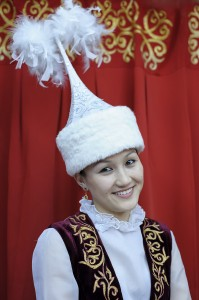 Kazakh lady shows off one of Kazakhstan's traditional costumes by David GABIS.