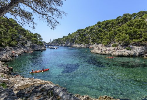 Kayaking in Cassis and more precisely in the calanque of Port-Pin, a famous tourist destination, South of France, Europe