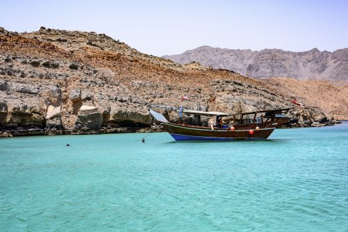 Traditional Arabic Dhows in the wild fjord of Musandam