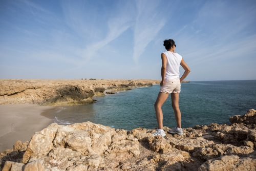 Woman admiring the wild coast of Ras Al Jinz, Oman 🇴🇲