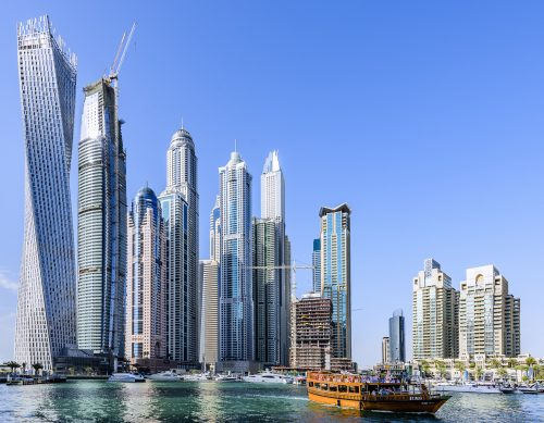 Dubai Marina Walk with CAYAN tower (1st from the left), PRINCESS Tower (5th from the left). Dubai Marina is a district in Dubai, United Arab Emirates. It is an artificial canal city, built along a two-mile (3 km) stretch of Persian Gulf shoreline. When the entire development is complete, it will accommodate more than 120,000 people in residential towers and villas.