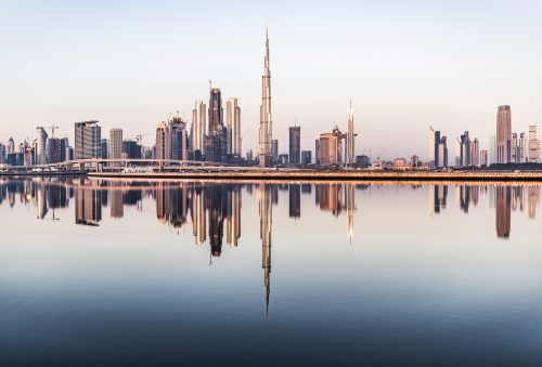 Dubai, United Arab Emirates. January 19th, 2018. clear weather on Dubai at sunrise United Arab Emirates. Buildings of the city reflecting on the water canal. United Arab Emirates, Middle East, Arabian Peninsula