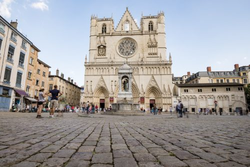 Cathedral Saint-Jean-Baptiste de Lyon with crowd, Roman Catholic church located on Place Saint-Jean in Lyon, France, Europe