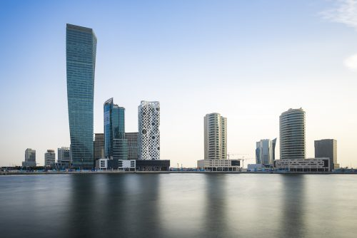 """Buldings at Business Bay and the O14 Executive Tower, winner of the silver Emporis Skyscraper Award 2009. Called also """"cheese grater"""" or """"Swiss cheese buidling"""", his concrete shell provides an efficient structure that help to reduce energy."""